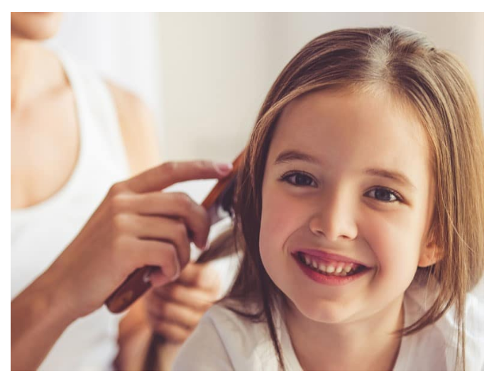 oiling-childrens-hair-for-hair-growth-in-hindi